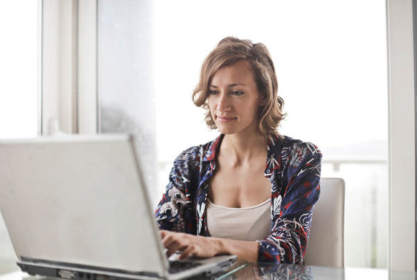 woman-in-blue-floral-top-sitting-while-using-laptop-806835.jpg
