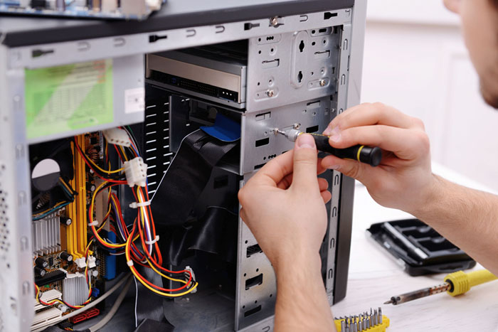 Technician Repairing a Workstation