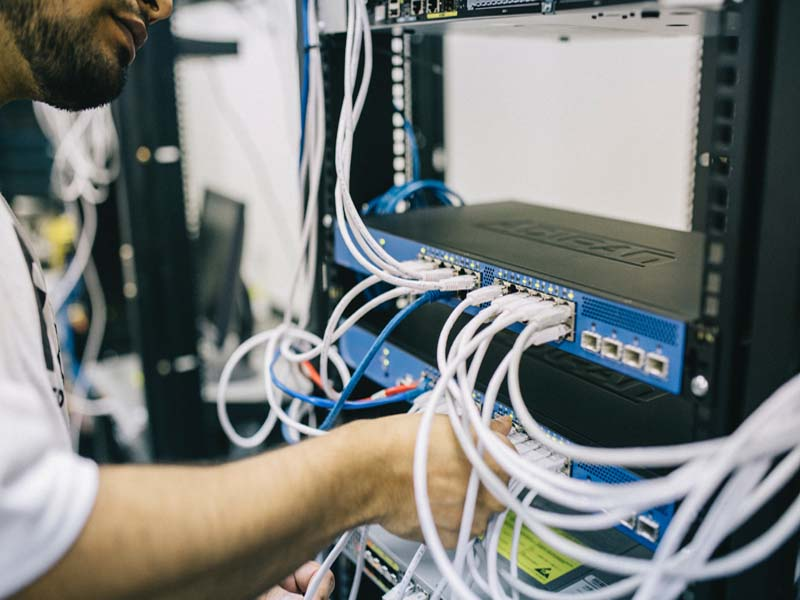 Field Engineer Providing IT Support by Repairing a Server for a Brookline Business