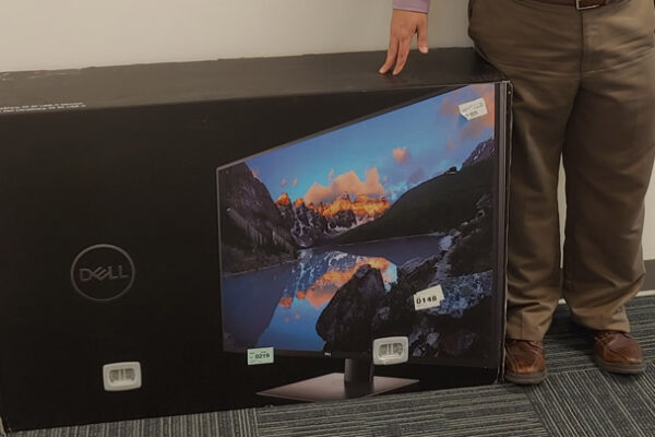 Dell Monitor on Floor for Scale Next to Man